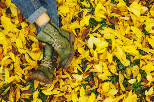 Leinwanddruck Bild Shoes in yellow autumn leaves