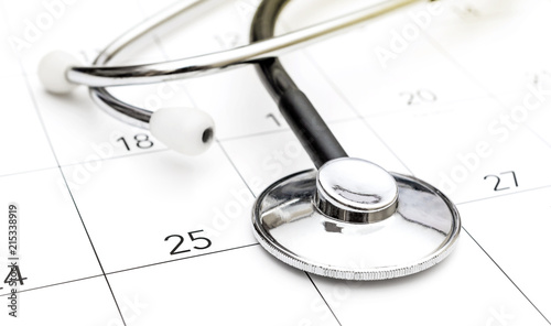 stethoscope on calendar medical appointment concept buy photos