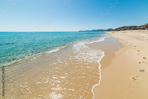 Golden sand and turquoise water in Piscina Rei beach