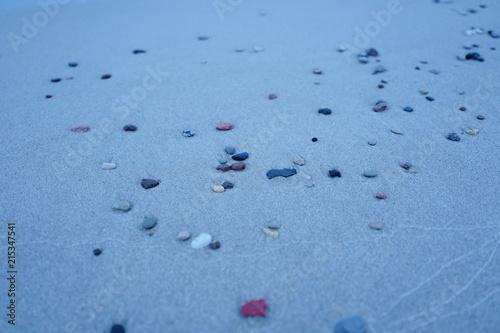 Plexiglas Zen Stenen Small pebbles on a sandy beach. Beach Amber. Kaliningrad region. Russia.