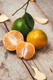 Close up of a mandarin orange isolated over white background.