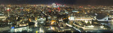 Panorama view of London taken from above at night, with buildings all lit up