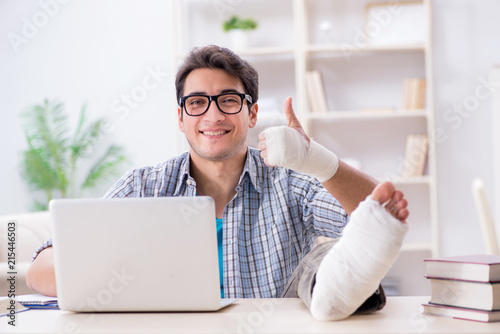 Freelancer with foot injury working from home - 215446503