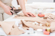 Leinwandbild Motiv Workplace of seamstress. Close up dressmaker cuts dress detail with scissors