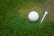 Golf ball is on green grass background