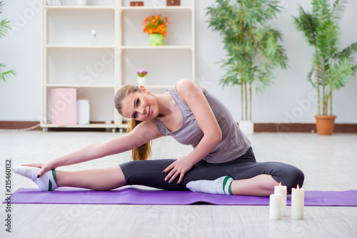 Leinwandbild Motiv Young woman exercising in sports hall in healthy concept