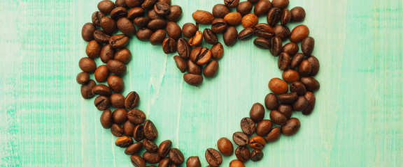 banner for website, coffee beans on brown matter, the heart of the coffee beans, background © byallasaa