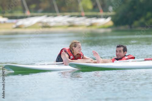 Fototapeta Couple having fun on surfboards