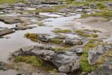 Flat wet rocks in Irish landscape