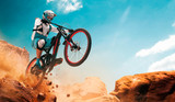 Cyclist riding a bicycle. Downhill. - 215535154