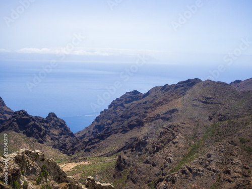 Foto Spatwand Blauwe hemel View of Masca village with palms and mountains, Tenerife, Canary islands, Spain