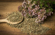 Leinwandbild Motiv Origanum vulgare (oregano) herb - spice on a table