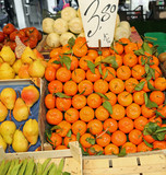 box of orange mandarines on the counter of a greengrocer