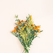 Bouquet made of fresh flowers on pastel beige background. Autumn, fall concept. Flat lay, top view, square