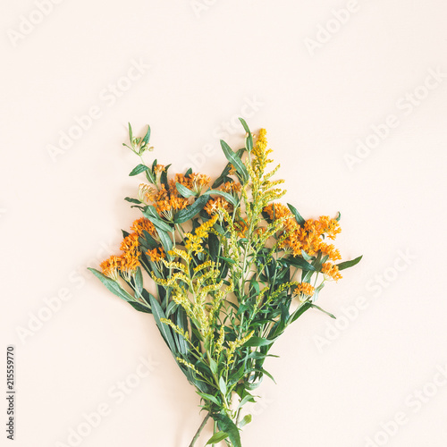 Bouquet made of fresh flowers on pastel beige background. Autumn, fall concept. Flat lay, top view, square - 215559770