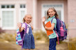 Leinwandbild Motiv Girls with backpack is going to school