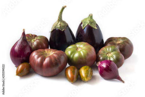 Foto Murales Organic heirloom tomatoes, eggplants, and onions isolated on white background