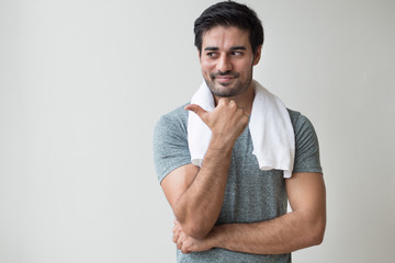 confident fitness man pointing thumb up gesture; portrait of happy, healthy, confident indian man training, working out in fitness gym; asian north indian adult man model © 9nong