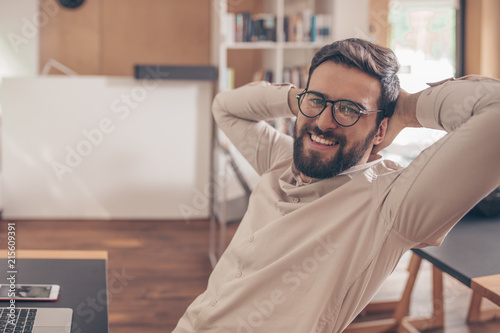 Foto Murales Smiling young man with eyeglasses
