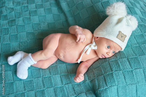 a6efd0ae158 Newborn baby with warm hat and socks. Top view. Funny cute child lying in