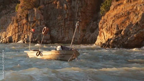 Fishing Boat Hooked on Mediterranean Sea Swaying with Waves © Ersin Koc