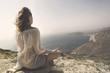 Leinwanddruck Bild - woman doing yoga exercises in front of a spectacular view
