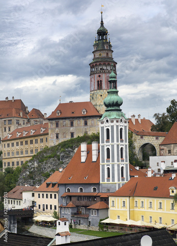 Cesky Krumlov castle and ancient historical houses and sky with stormy clouds, Czech Republic..