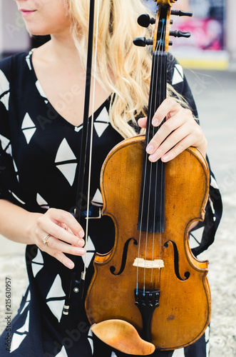 Violin hands on the background - 215630957