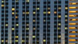 Illuminated windows of hotel , time lapse - 215639318