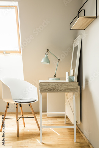 Foto Murales Lamp on desk in white workspace interior on attic with chair and
