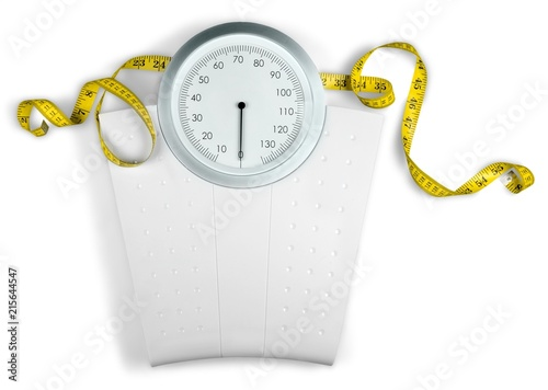 A Measuring Tape on a Weight Scale - 215644547