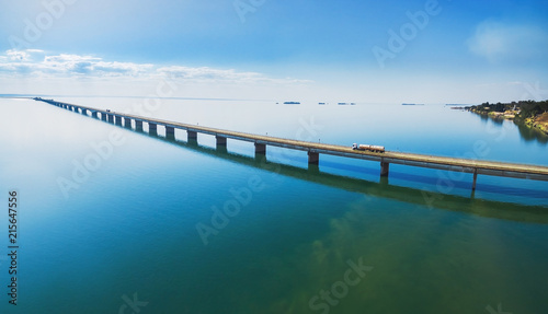 Aerial view of a long highway bridge above a river. Bridge Helio Serejo over the Parana river on the borders between Mato Grosso do Sul and Sao Paulo states in Brazil.