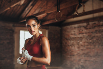 Woman preparing for boxing workout © Jacob Lund