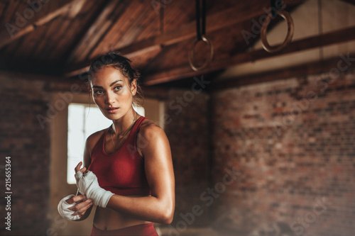 Woman preparing for boxing workout - 215655364