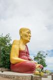 Buddist monk statue on the mountain in Koh Lan island