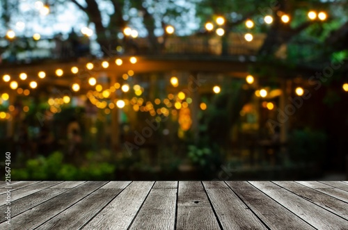 empty modern wooden terrace with abstract night light bokeh of night festival in garden, copy space for display of product or object presentation, vintage color tone - 215674360