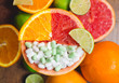 Vitamin C in citruses and supplement. Concept