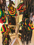 many hats with the colors of the Jamaican flag for sale in the costume shop