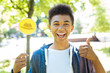 Sunny sides. Handsome beaming student seeing sunny sides of situation while using thinking hats