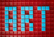 Above view of word ART laid out in blue square tiles over red base, copy space background