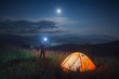 Leinwanddruck Bild - Man hiker with flashlight