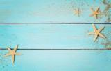summer seashells on wooden background - 215717585