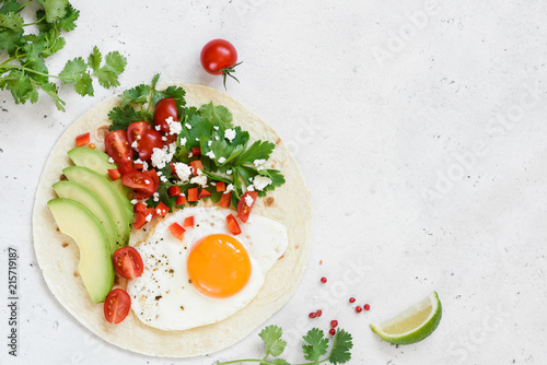 Flatbread with avocado, egg and mexican salsa. Top view with copy space for text. Healthy breakfast or lunch food - 215719187