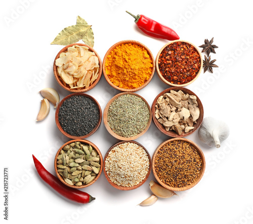 Leinwandbild Motiv Beautiful composition with different aromatic spices on white background