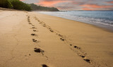 Footsteps on Early Morning Beach