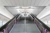 Escalator and stairs to underground train station
