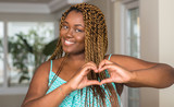 African american woman at home smiling in love showing heart symbol and shape with hands. Romantic concept. - 215745959