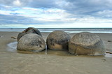 Stone balls on a sandy beach in New Zealand