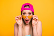 Leinwandbild Motiv Summer discounts for travel! Close up portrait of shocked and surprised girl looks at the camera over glasses with wide-open eyes and mouth isolated on shine yellow background.