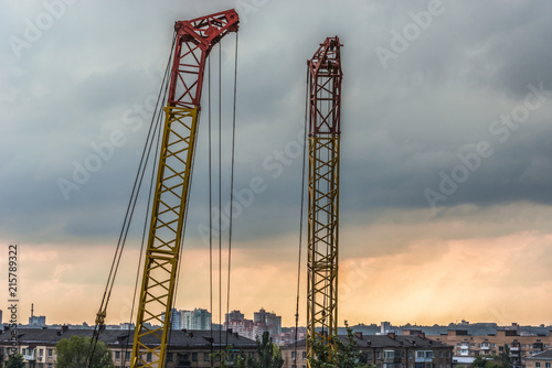 Canvas Kiev Construction cranes against a thunderstorm in the city of Kiev, Ukraine.
